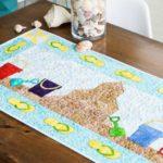 pq11618-summer-sandcastle-table-runner-lifestyle-web
