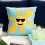 pq11650-sunshine-emoji-pillow-lifestyle-web_1