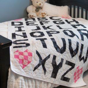 pq11715-abcs-throw-quilt-lifestyle-web-2