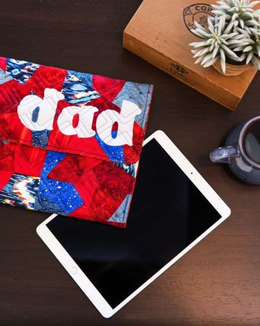pq11877-go-scrappy-tablet-sleeve_dad_lifestyle_web